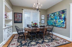 Chicago Guest House Vacation Rental Airbnb in Chicago Dining room with paintings on the wall