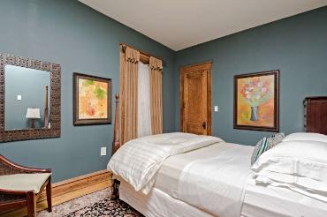 Queen bedroom with blue walls
