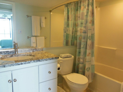 Completely remodeled bathroom with a shower and tub combo.
