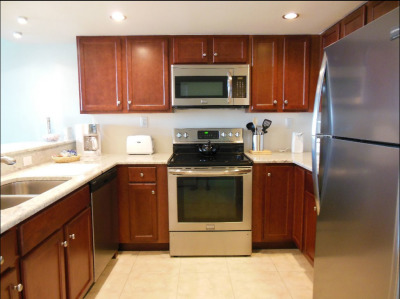 Completely remodeled kitchen with granite counters and stainless appliances.