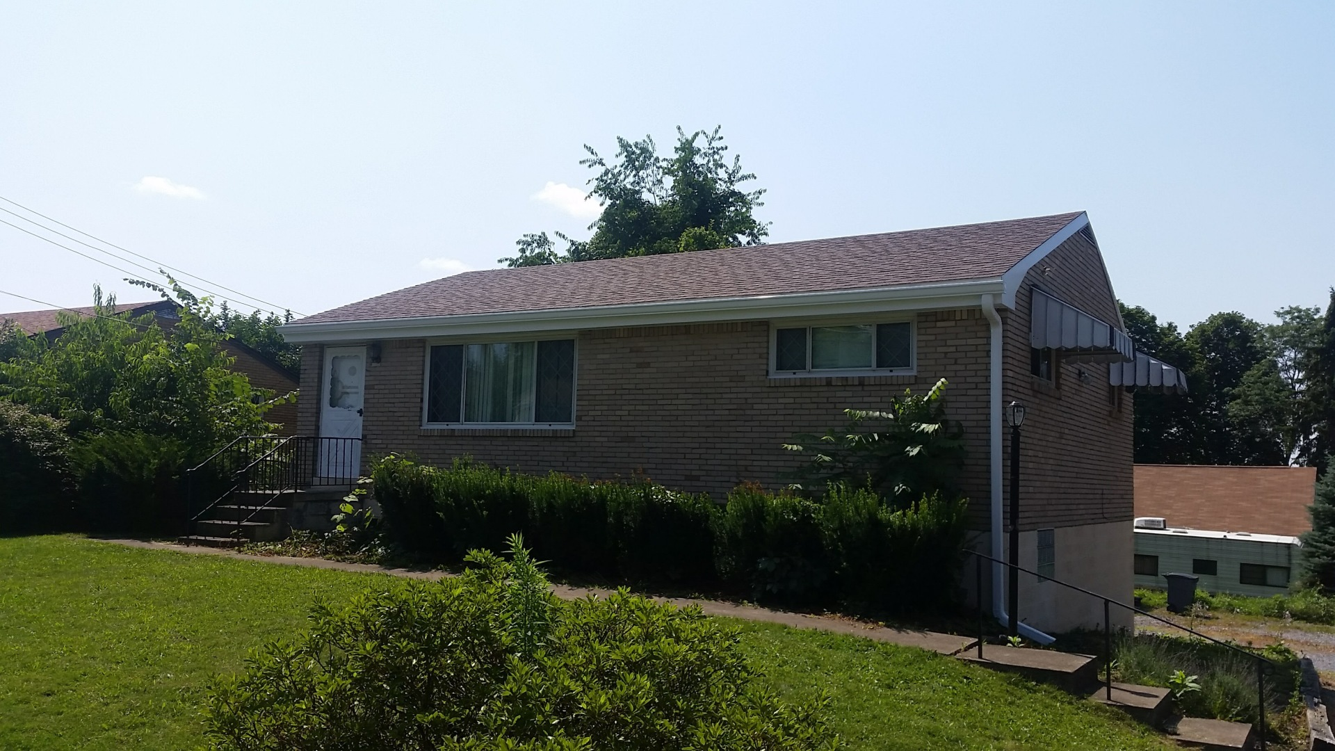Owens Corning Duration Brownwood (new soffit, fascia, gutters)