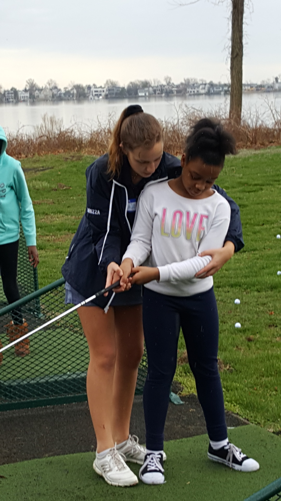 Sophie Carozza teaching Genesis how to hit