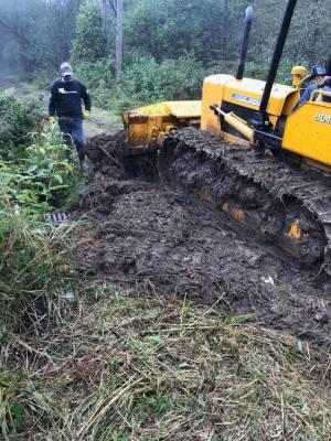 Huge mud hole undergoing repair