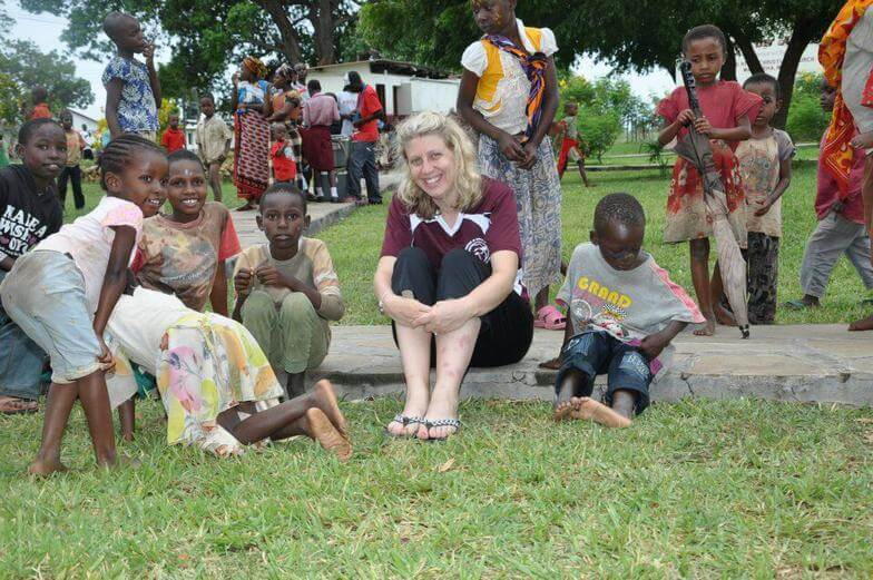 Carrie surrounded by Kenyan children