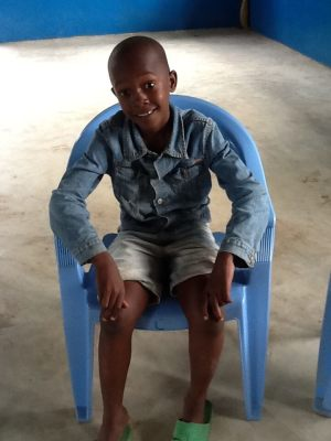 young boy in blue chair