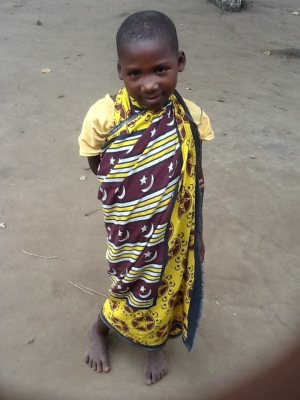 young boy in traditional Kenyan dress