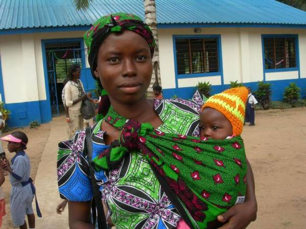 young mother in traditional dress holding baby