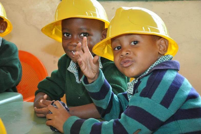 preschool kids in construction hats