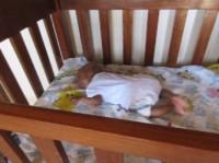 baby Joseph asleep in crib