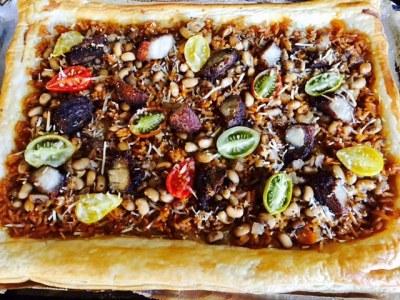 Priscilla's  Jollof Rice & Beans & Crispy Goat meat Tart