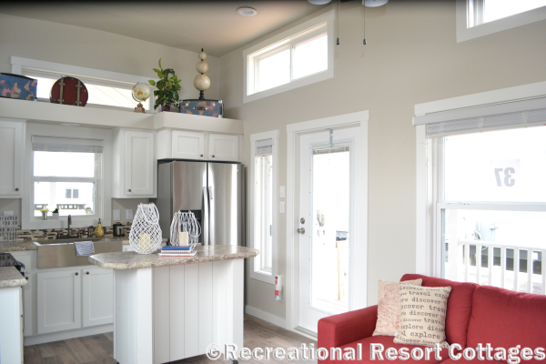 RRC-Platinum Cottages 528FPSP Meadowview kitchen and living room