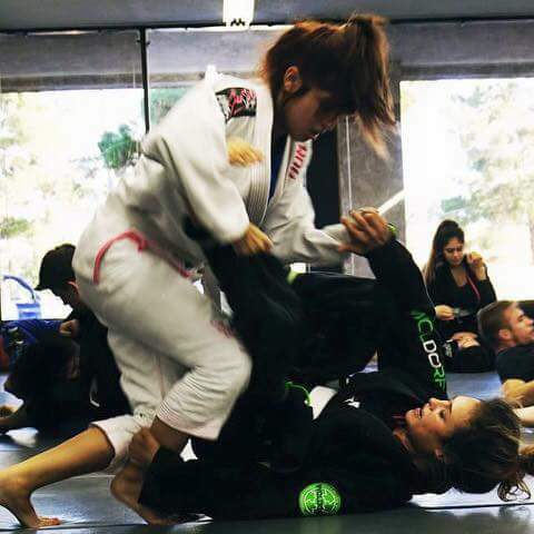 SCFF Students Alyssa Hurst and Destiny Sarran during BJJ class
