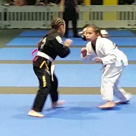 SCFF Student Selena Gudmundson (in white) at BJJ Competition