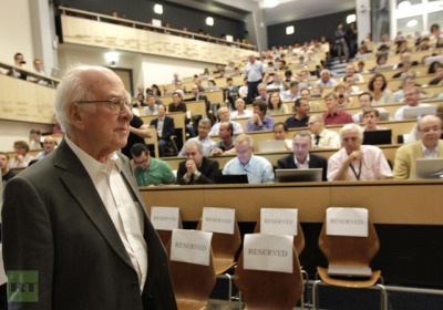 Peter Higgs arrives at the press conference