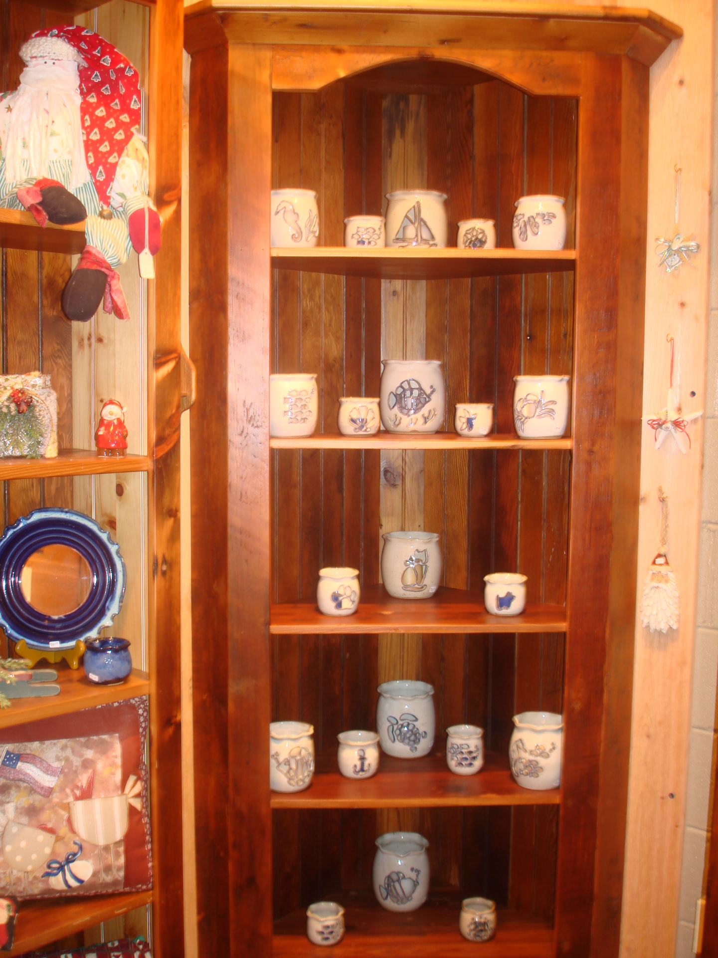 Shelves filled with hand made & hand painted pottery
