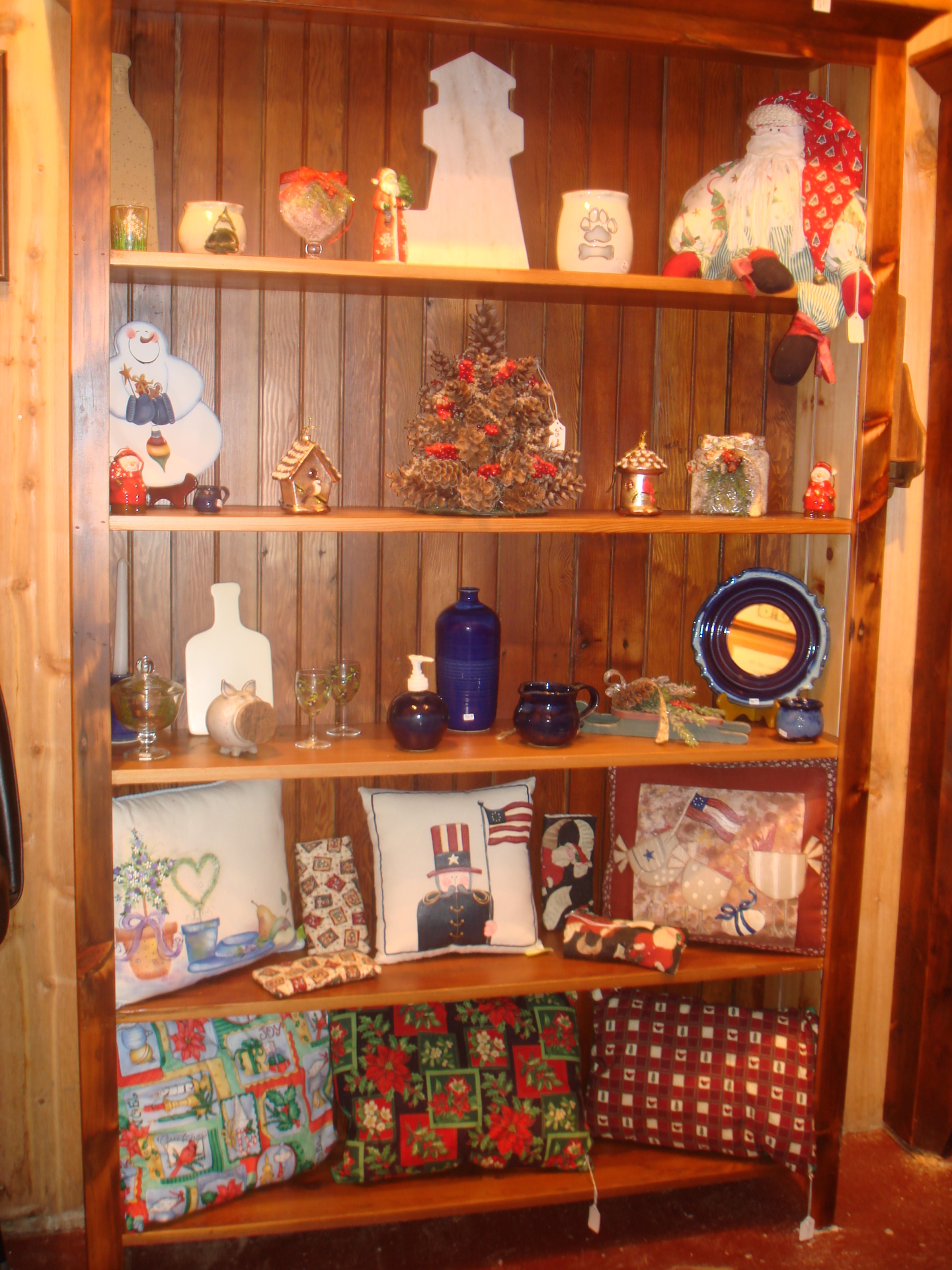 Shelves filled with cutting boards and other gift items