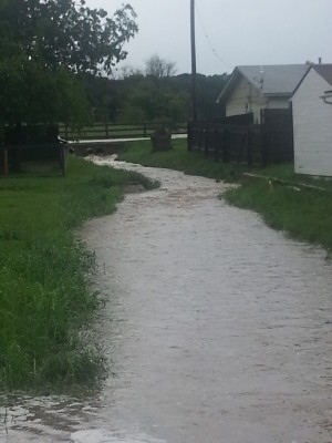 Flood waters rushing from Stonecrest to Charyl Lynn