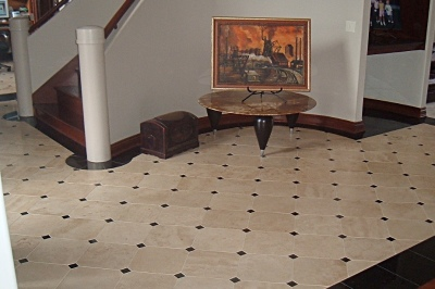 Cream travertine with black granite entry
