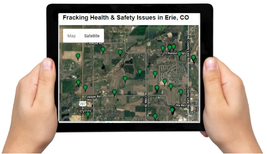 iPad held between two hands showing fracking problems in Colorado on a map.