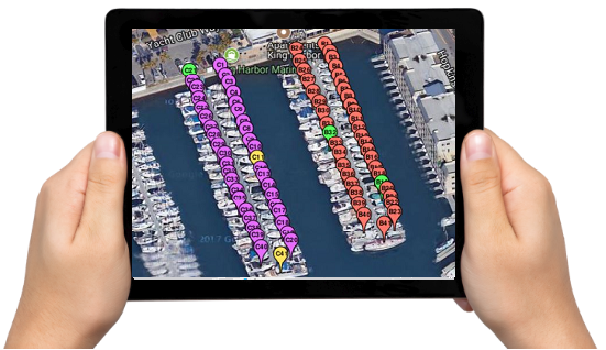 iPad held by two hands showing boat slips on a satellite image map available to lease or use temporarily.