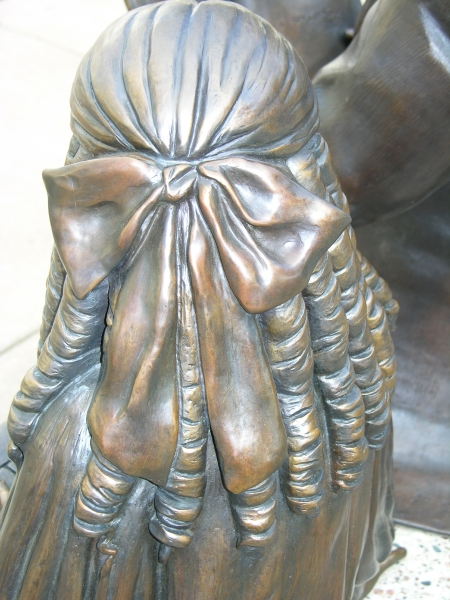 View of Girl in Treasured Moment Statue. Hair