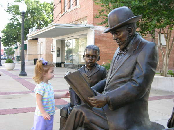 Little Visitor to Treasured Moment Statue