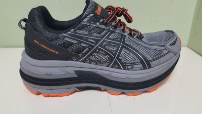 Gray and Orange Shoe Lift for a Leg Length Discrepancy