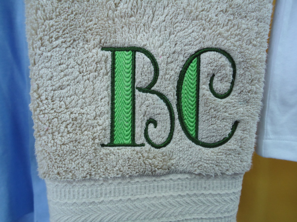 "<img source=""pic.gif"" alt=""Monogramming Towels in Goldsboro NC area.""</img>"