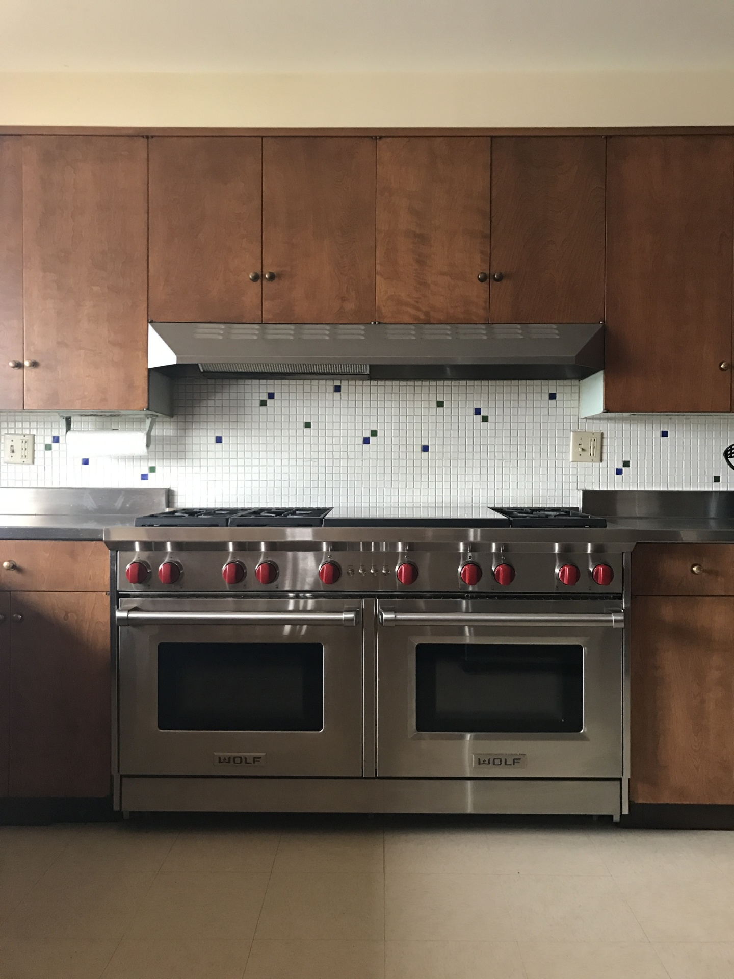 "Big 60"" Wolf double oven with six burners and double griddle"
