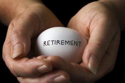 cradling a retirement nest egg in hand