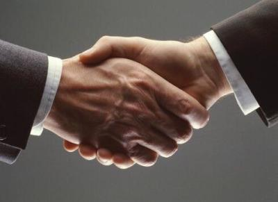 financial advisor shaking hands