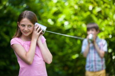 children talking on string can phone