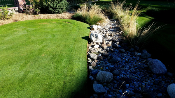Great attention to detail with the golf greens on the left and rock water way on the right.