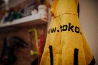 Ski waxing apron, hanging on door in ski workshop