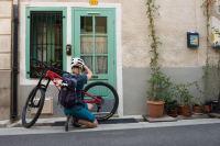 Enduro mountain biker repairing his bike in Innsbruck