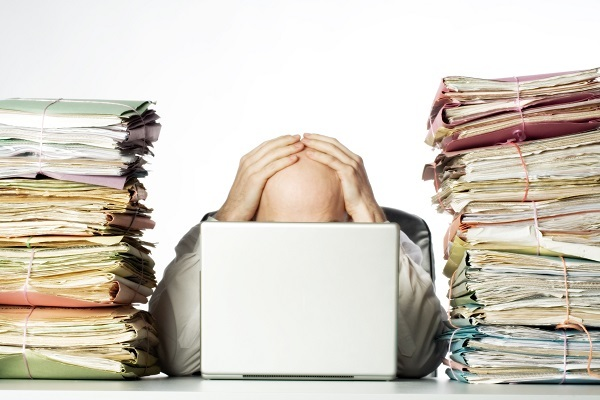 Frustrated man with paperwork