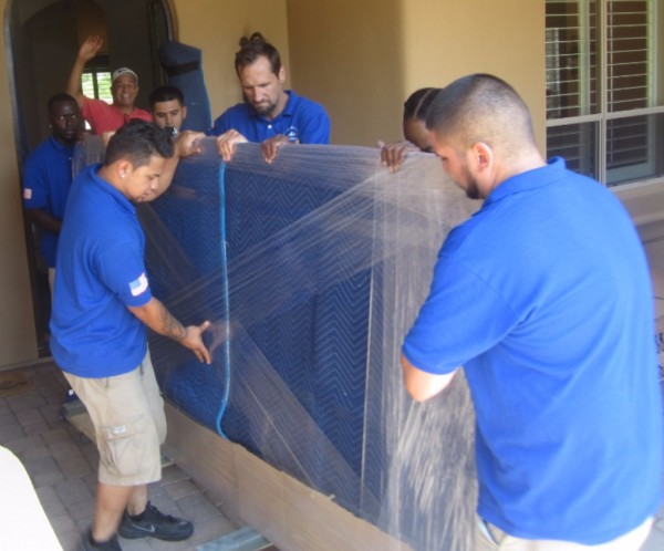 Phoenix Arizona Moving Crew moving a dining room table