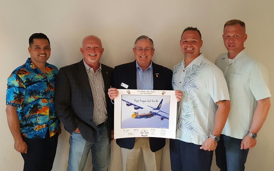 Fat Albert Crew presents signed photo to Council