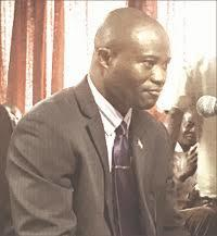 Dr. Denis Sandy, Minister of Lands,