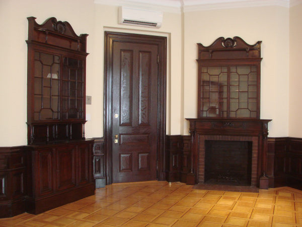 The living & dining area features a built-in mahogany hutch and fireplace (non-working). 404 Marlborough Street