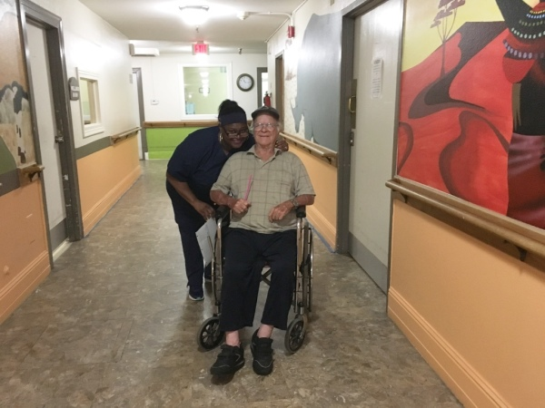One of Our Med Techs with a Resident