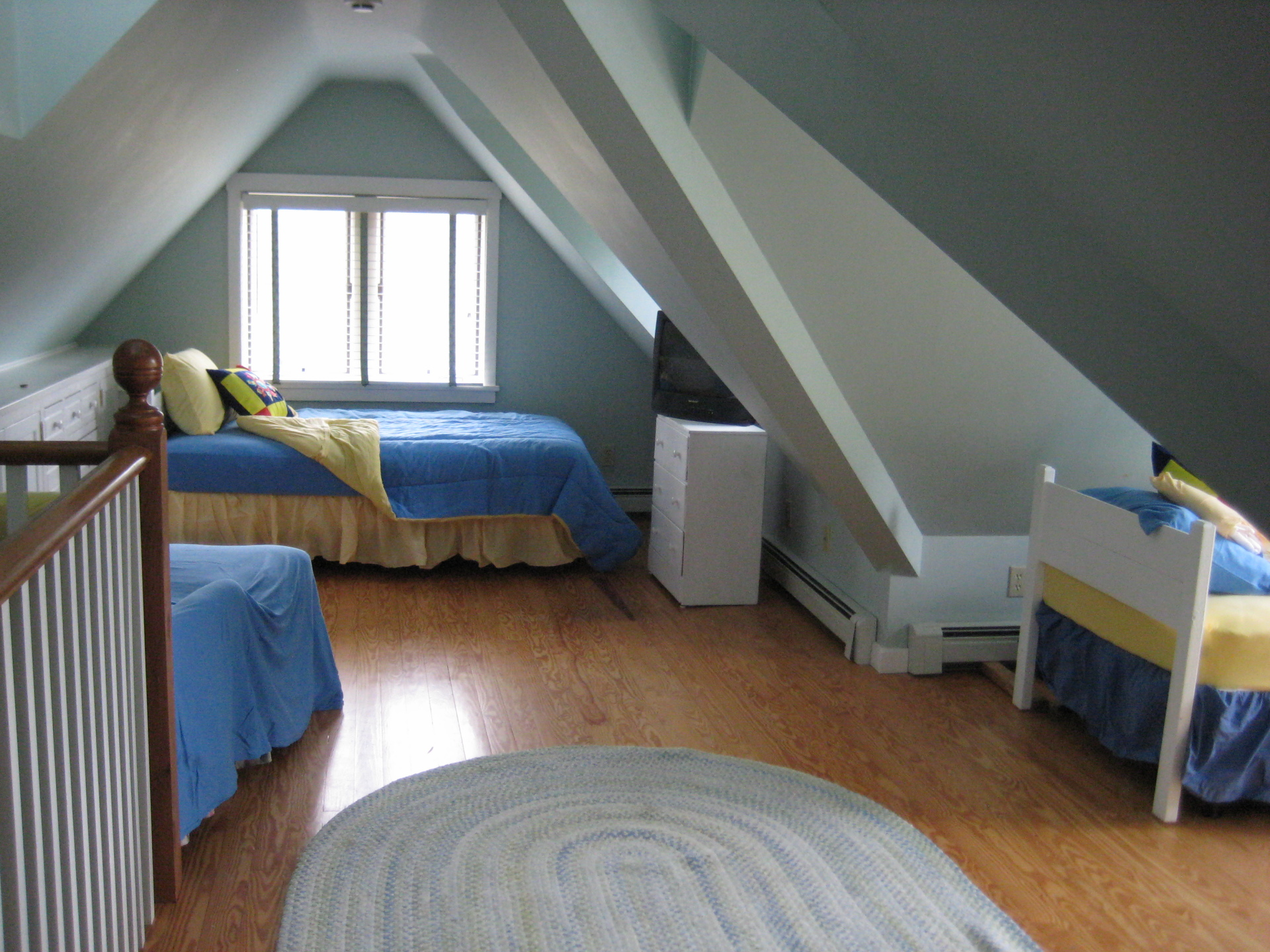 Third Floor bedroom with three twin beds and full bathroom