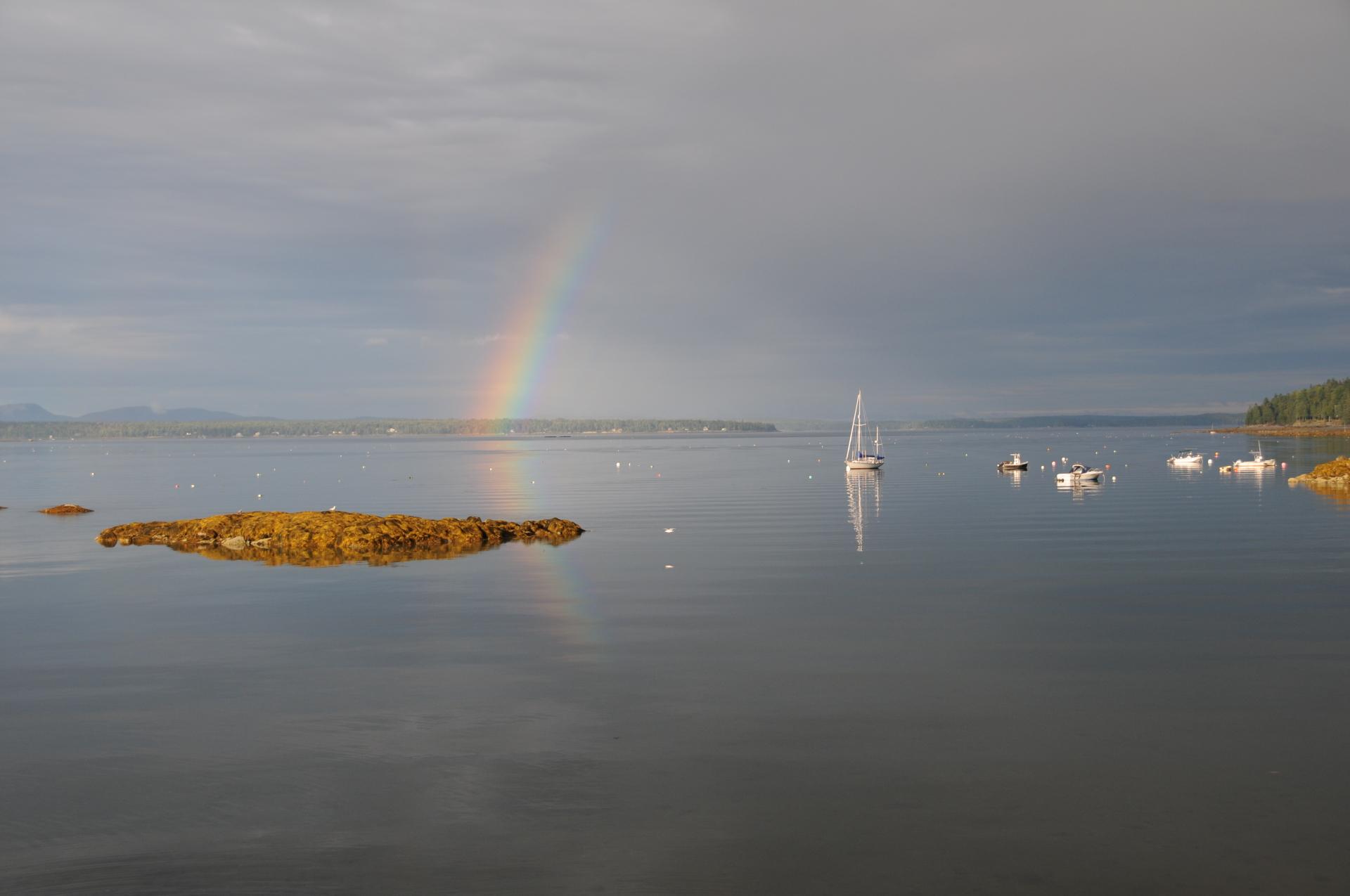 Rainbow over calm cove