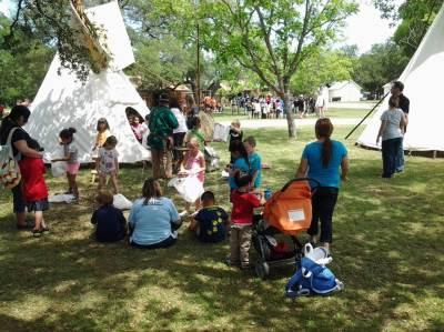 Kids touring Pioneer tent