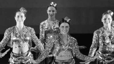 Tap dancers in sparkly costumes