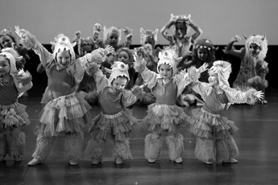 Young dancers in monster costumes on stage
