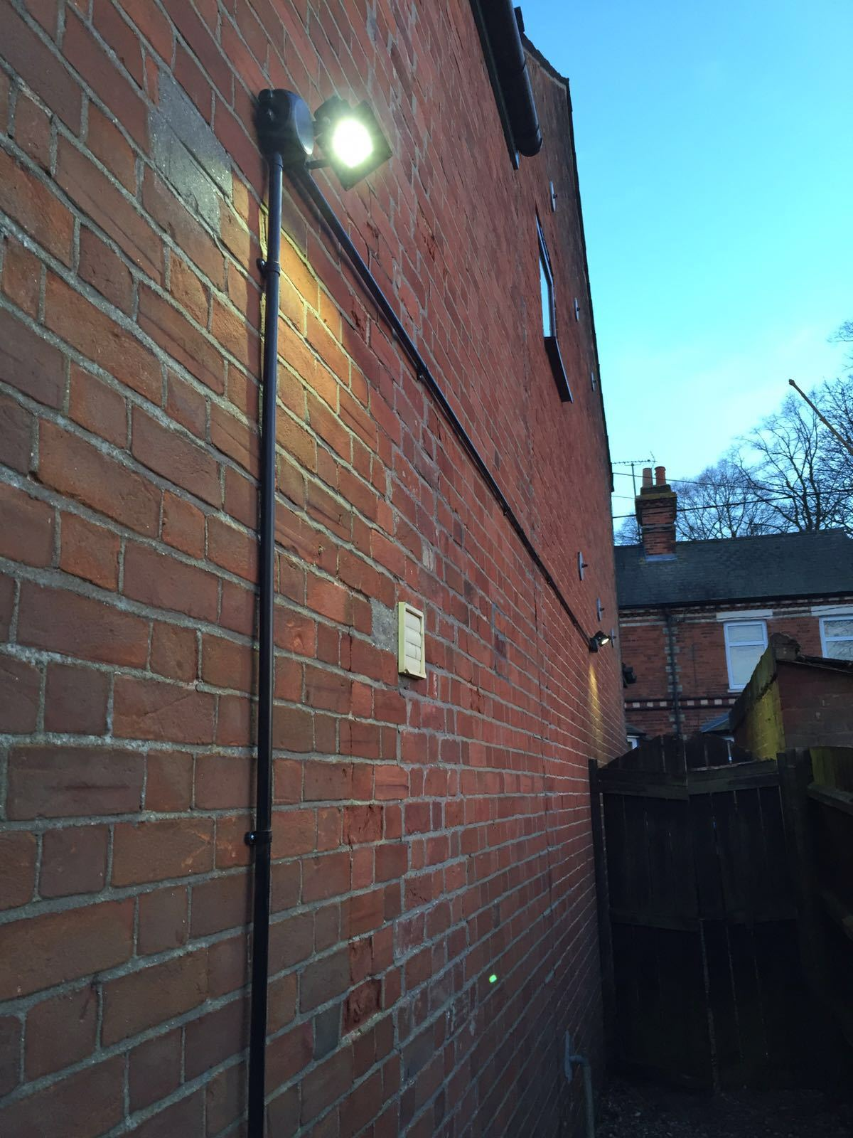 Outdoor LED security light fitted with junction box