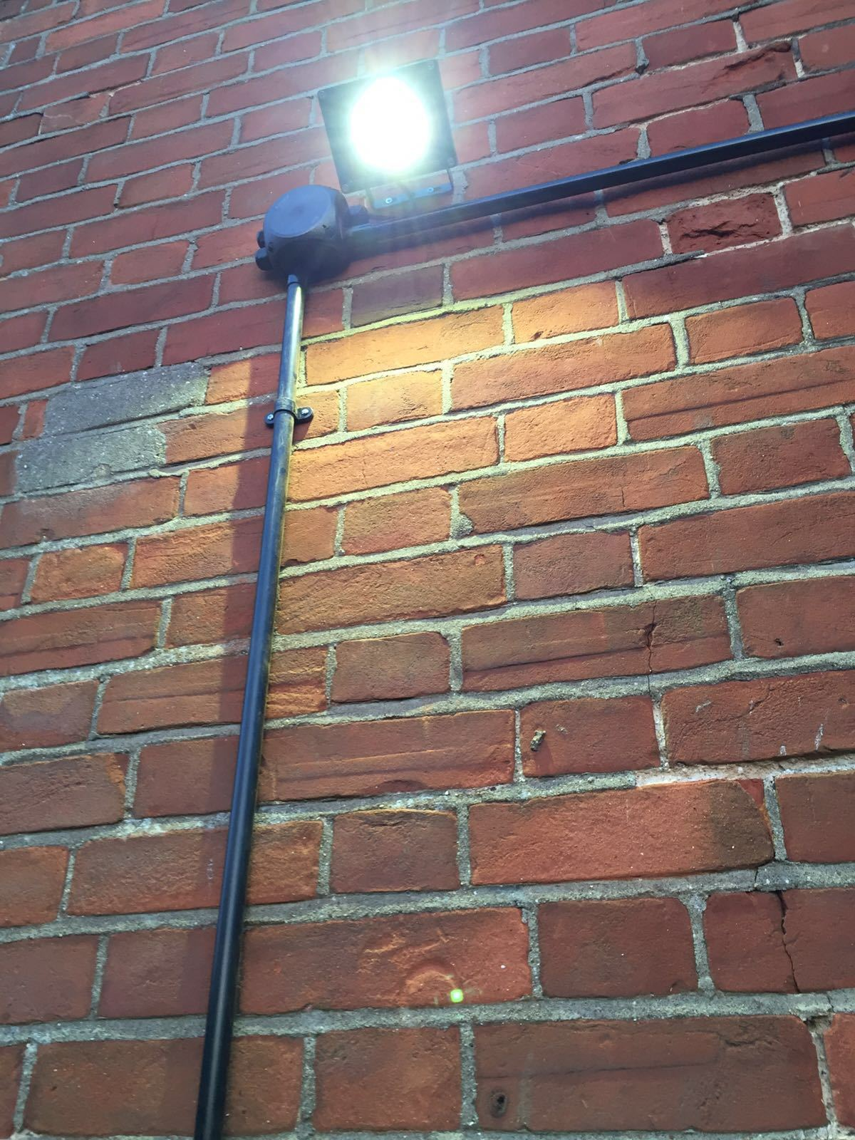 Outdoor LED security light fitted with junction box by an electrician at Scarlett Electrician