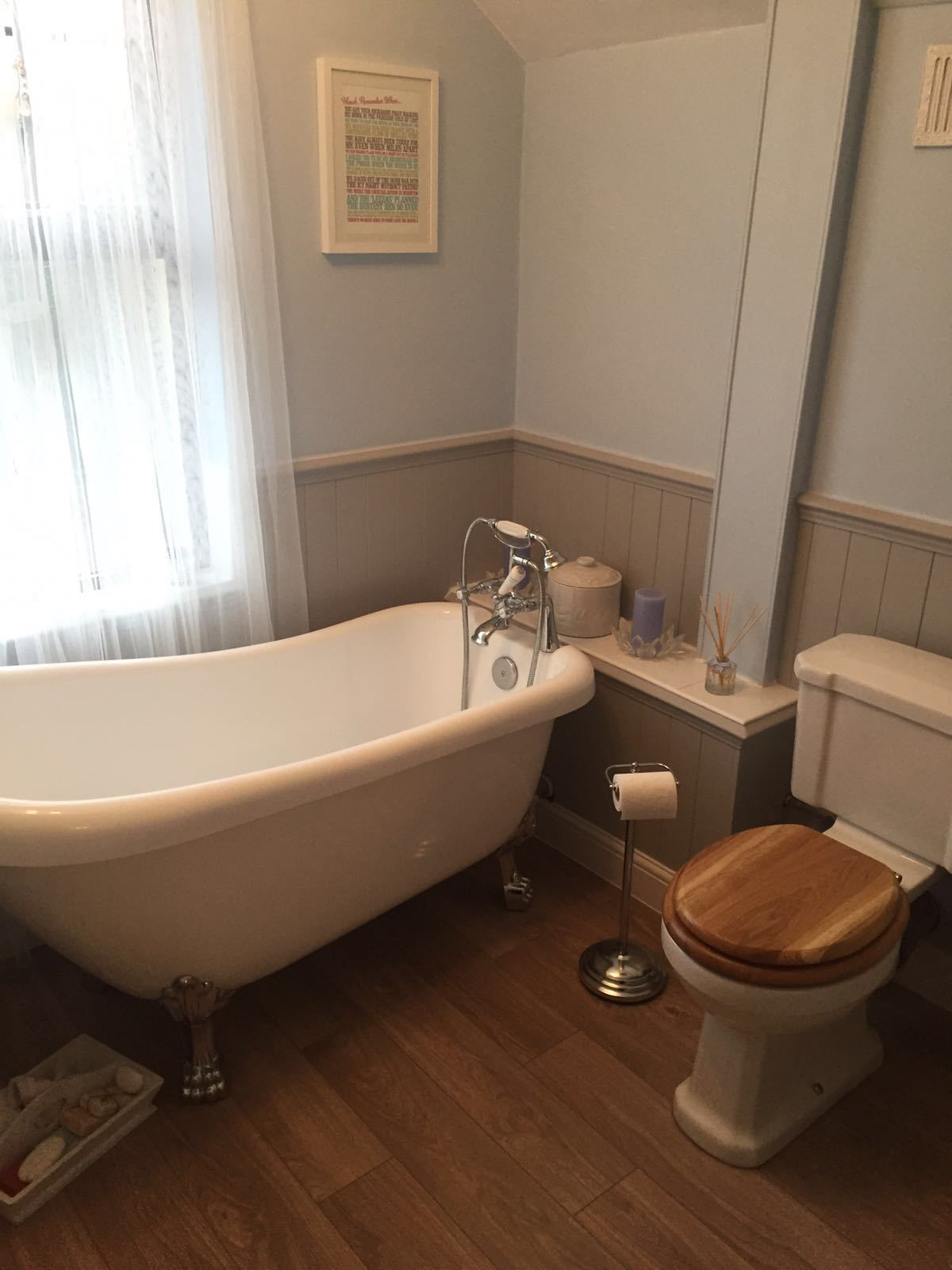 Newly fitted bathroom in Suffolk, all work carried out by Scarlett Electrical including plumbing, cladding, tiling, flooring, skirting boards, electrics and decorating