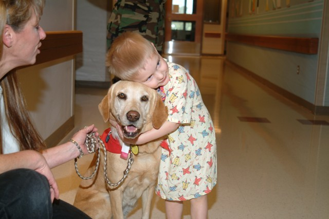 Pet Therapy Visit child with dog